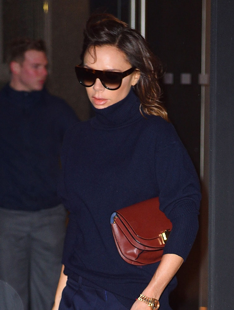 Here S Victoria Beckham Leaving Her Nyc Hotel With A Bag Of Own Design Burnt Red Leather Half Moon Just Presented